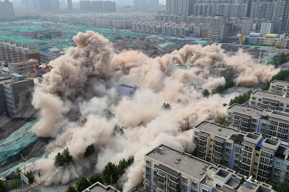 פיצוץ מבוקר של בניין בז'נגז'ו, סין (צילום: רויטרס)