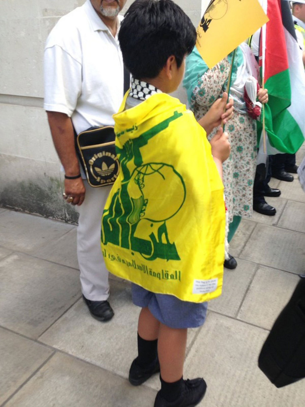 Child attending the march wrapped in a Hezbollah flag (Photo: World Jewish Congress)
