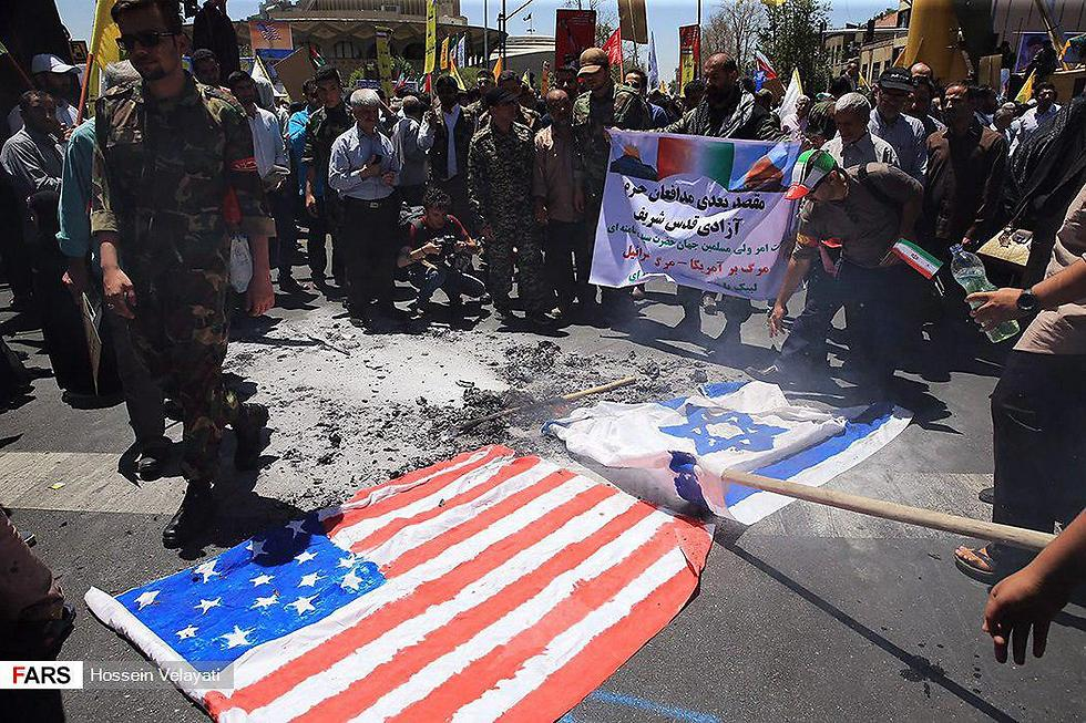 Burning Israeli and American flags