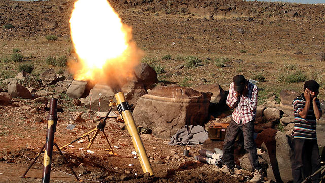 Syrian rebel fire (Photo: Reuters)