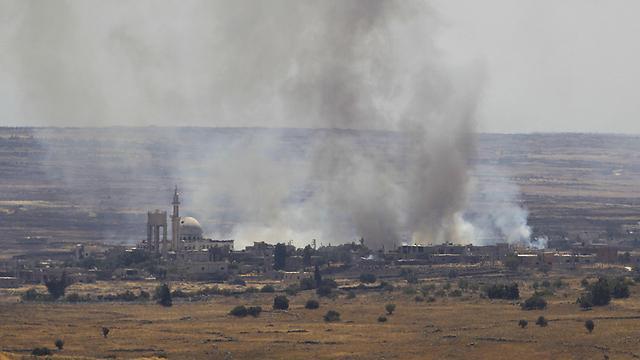 הלחימה בצד הסורי של רמת הגולן, ליד גבול ישראל (צילום: AFP) (צילום: AFP)