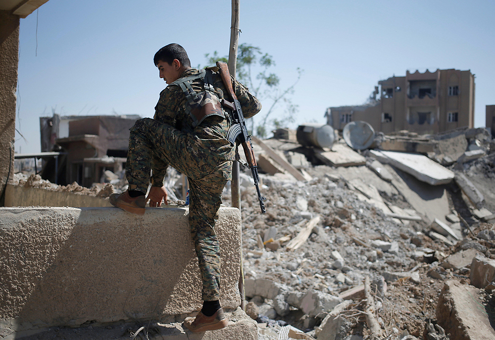 A Kurdish fighter in Syria (Photo: Reuters) (Photo: Reuters)