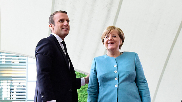 German Chancellor Angela Merkel and French President Emmanuel Macron (Photo: AFP)