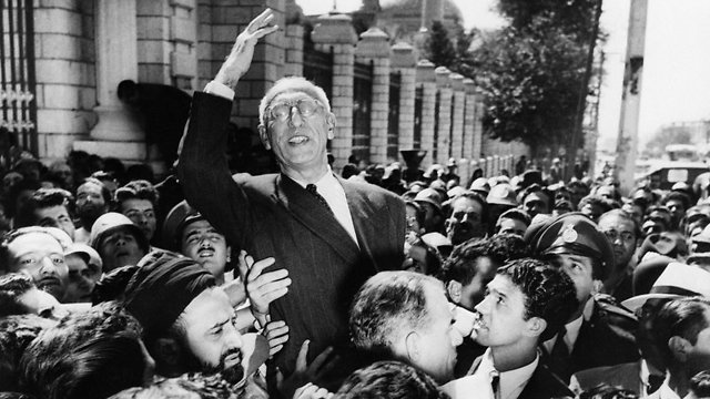 Prime Minister Mohammed Mosaddegh rides on the shoulders of cheering crowds in Tehran's Majlis Square, 1953 (Photo: AP)