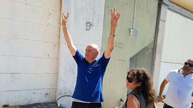 Ghattas, 'head raised high' before entering prison