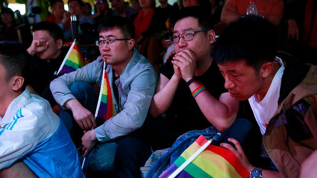 """מפגש להט""""בים והוריהם בסין. נקודת מפנה משפטית? (צילום: EPA)"""