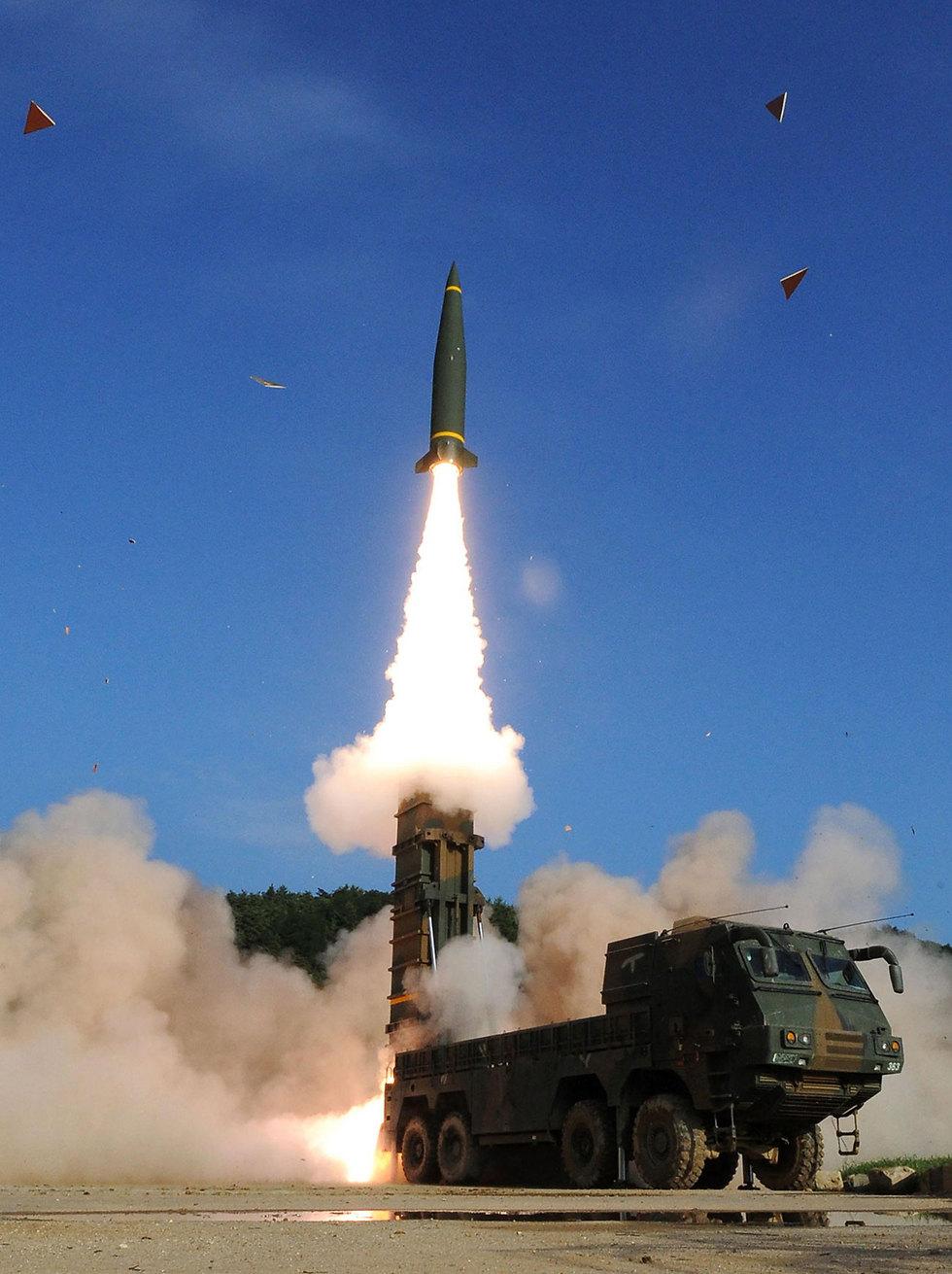 ניסוי הטילים בדרום קוריאה (צילום: AFP) (צילום: AFP)