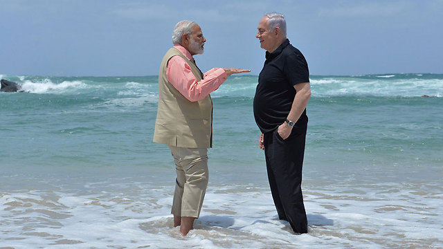 Netanyahu and Modi talk a walk on the beach during Modi's visit to Israel in July (Photo: Kobi Gideon, GPO)