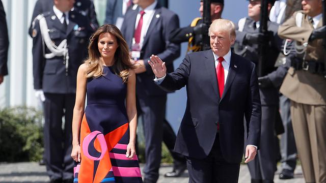 טראמפ והגברת הראשונה מלניה בפולין (צילום: AP) (צילום: AP)