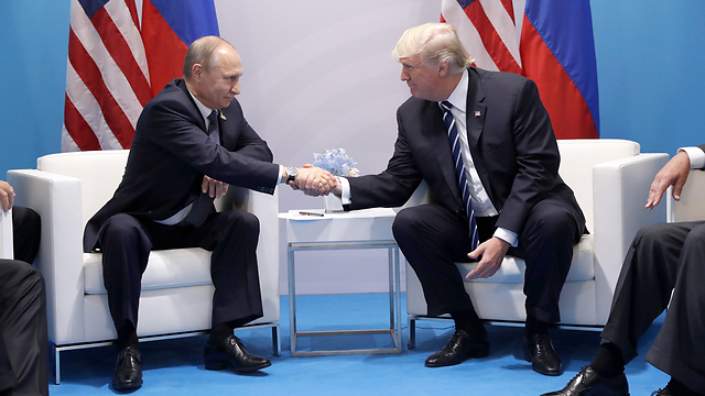 Trump and Putin meet in Hamburg (Photo: AP)