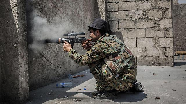 Kurdish fighters in the al-Raqqah area (Photo: MCT)