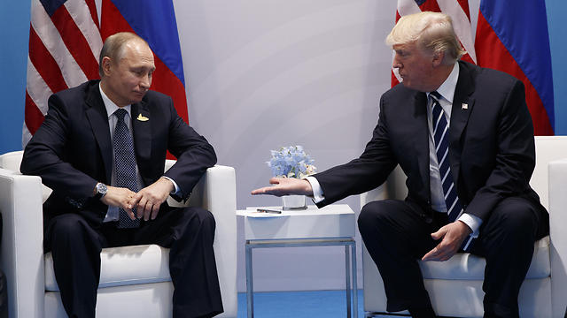President Trump with President Putin (Photo: AP)
