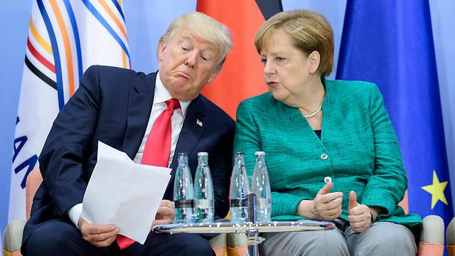 הנשיא דונלד טראמפ והקנצלרית אנגלה מרקל. מכסים עלולים לפגוע ביצוא החשוב של מכוניות מגרמניה (צילום: gettyimages)