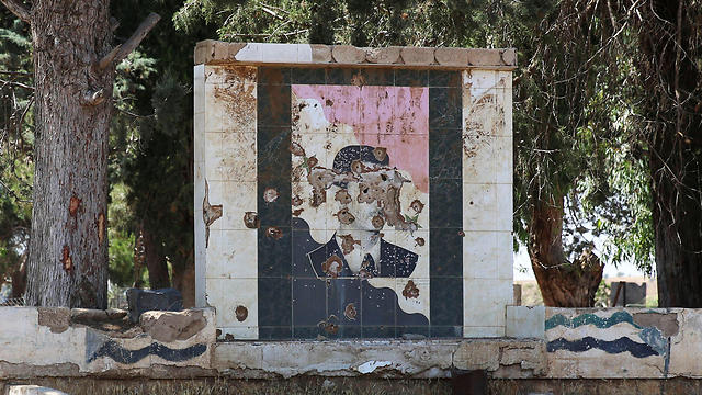 A picture of Syrian President Assad riddled with bullet holes in the Quneitra area, not far from Israel (Photo: Reuters)