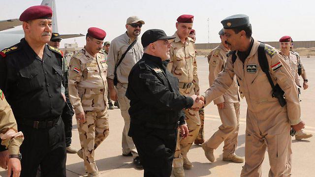 Iraqi Prime Minister Haider al-Abadi congratulates troops in Mosul.