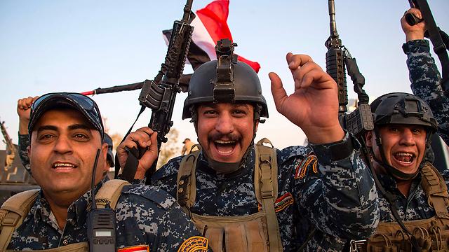 חגיגות הניצחון על דאעש (צילום: AFP) (צילום: AFP)