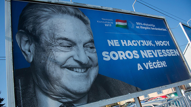 Hungarian government poster portraying financier George Soros and saying 'Don't let George Soros have the last laugh' (Photo: AFP) (Photo: AFP)