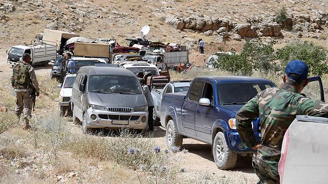 אנשי חיזבאללה מאבטחים את האזור (צילום: רויטרס)