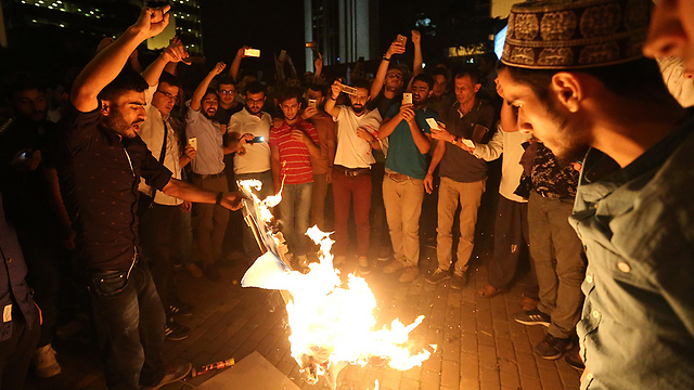 Israeli flags burned in Istanbul following the attack (Photo: AFP)