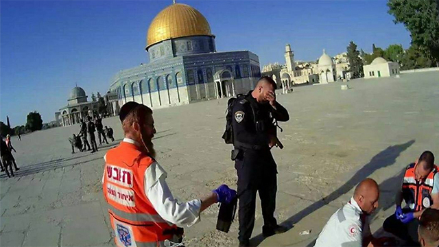 A police officer crying following the attack on the Temple Mount.