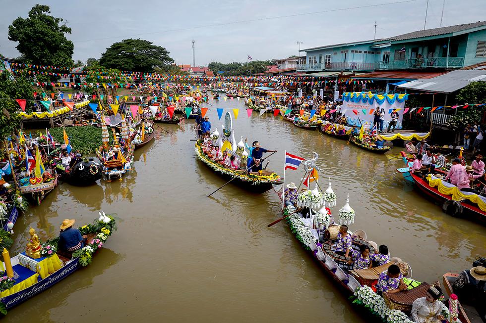 """פסטיבל בודהיסטי לרגל תחילת חודשי """"קאו פאנסה"""" באיוטהאיה, תאילנד (צילום: EPA)"""