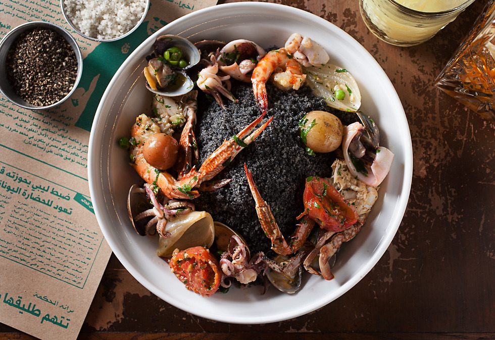 """קוסקוס שחור עם פירות ים במסעדת """"נור"""" (צילום: חיים יוסף) (צילום: חיים יוסף)"""