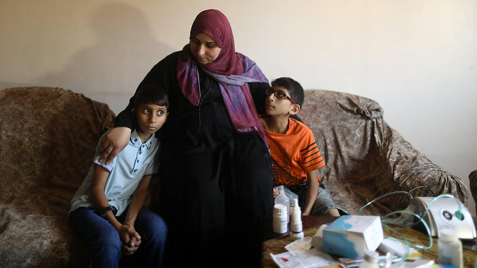 Mustafa and Mohammad Shanty with their mother (Photo: Reuters)