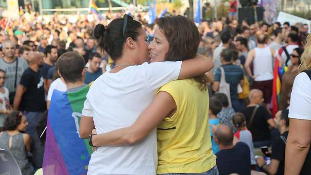 Same-sex couple at LGBT demonstration for equal adoption rights (Photo: Motti Kimchi)