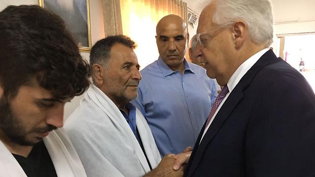 Amb. Friedman (R) paying his condolences