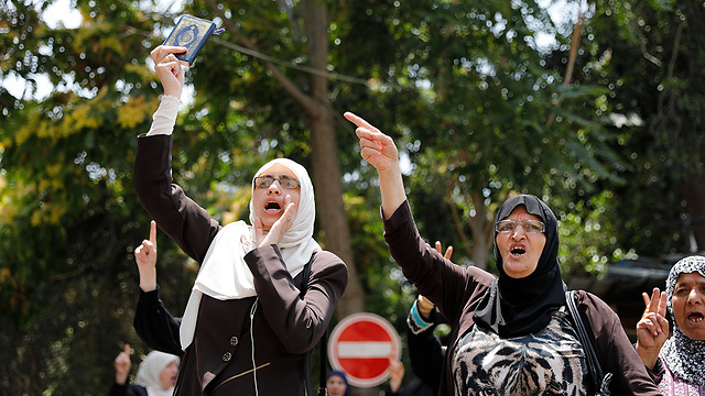 Muslim women protest the added security measures (Photo: EPA)