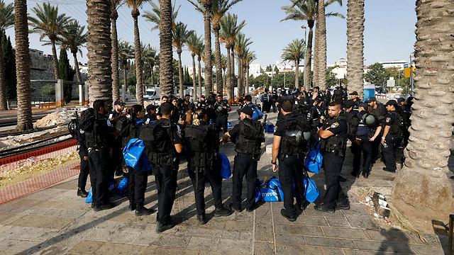 Police assemble near site (Photo: EPA)