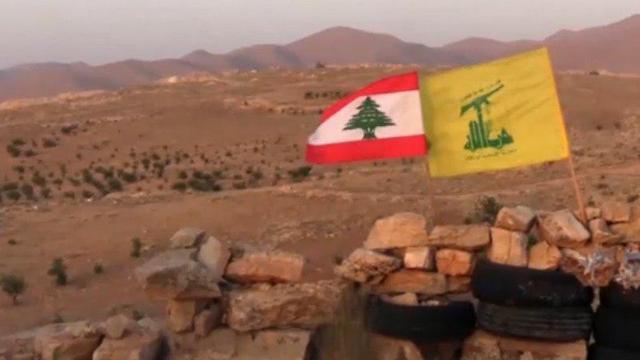 Hezbollah flag over a conquered position in Syria
