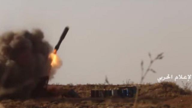 Hezbollah firing missiles at rebel positions