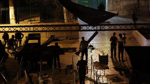 Демонтаж металлодетекторов у Храмовой горы. Фото: AFP