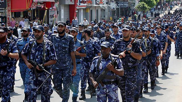 Hamas militants marching in Gaza (Photo: AP)