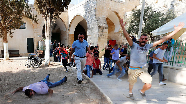 Worshippers celebrating at Temple Mount (Photo: Reuters)