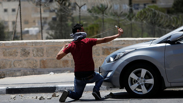 Rock thrower in Bethlehem (Photo: Reuters)