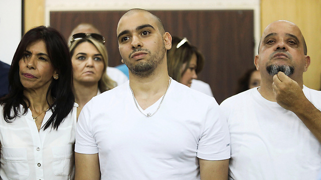 Elor Azaria with his parents in court Sunday (Photo: Reuters) (Photo: Reuters)