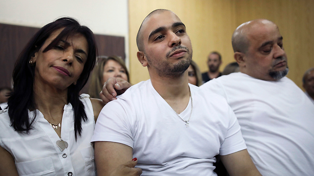 Elor Azaria and his parents in court, Sunday. They must understand that people pay a price for the choices they make in life (Photo: AP)