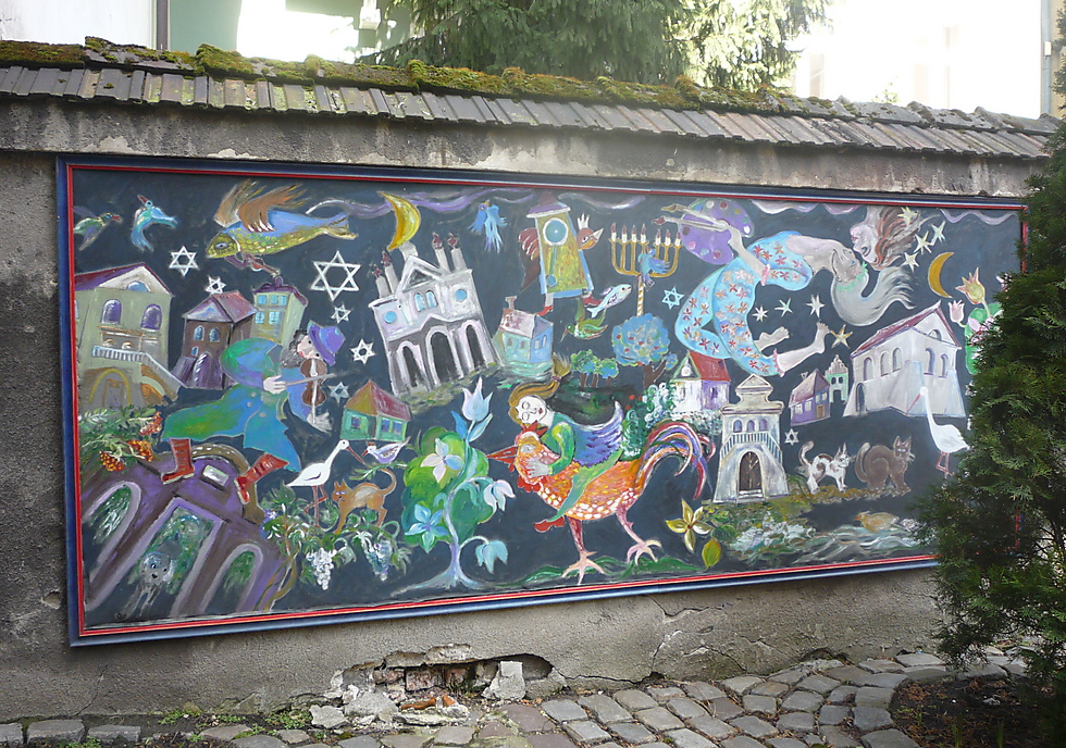 Grzegorz Sadurski, JCC Krakow, Krakow, Poland: This street art is a sign of revitalization in Krakow's Jewish Quarter of Kazimierz. Jewish symbols in the style of artist Marc Chagall recall history and life in Kazimierz. They evoke ritual, music and folklore to tell the continuing story of Jewish life in Poland.