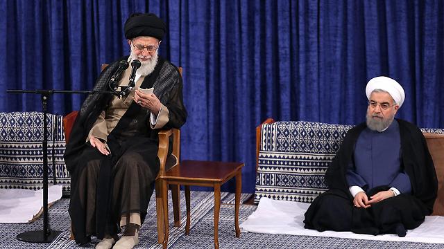 נשיא איראן רוחאני והמנהיג העליון חמינאי (צילום: רויטרס)