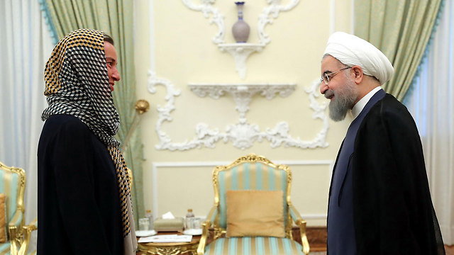 Mogherini meets with Rouhani in Tehran (File photo: AFP)