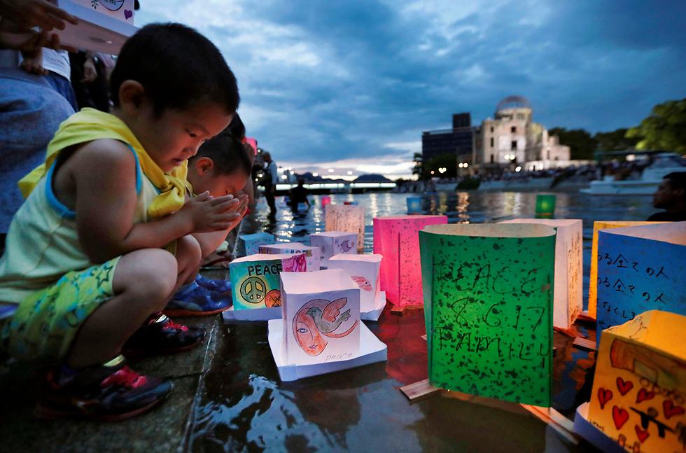 פנסי נייר לזכר קורבנות ביום השנה להפצצת הירושימה, יפן (צילום: רויטרס, Kyodo)