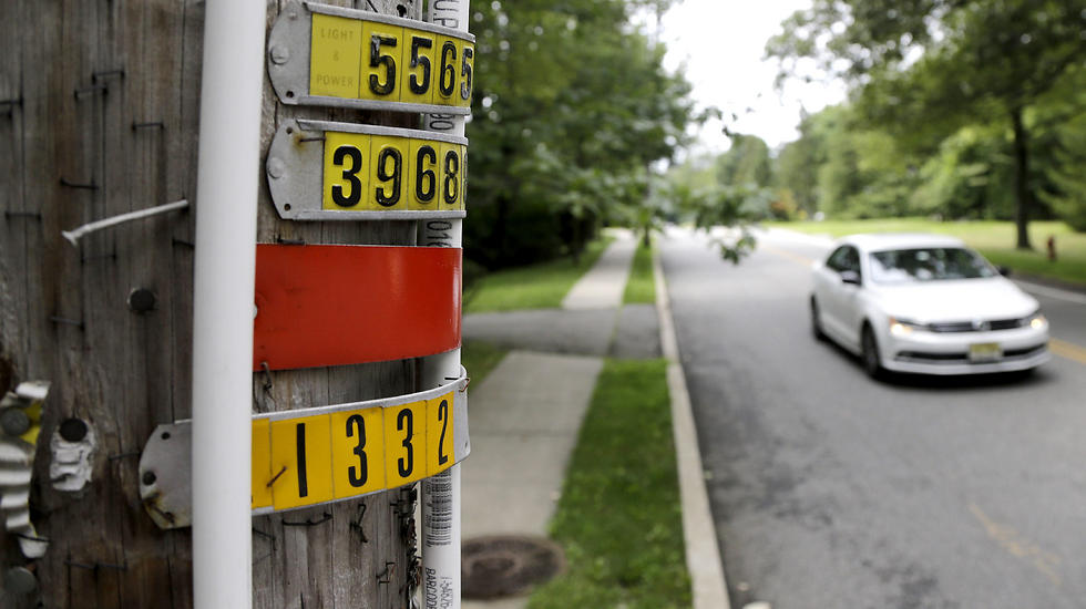 PVC piping placed on utility poles around a New Jersey town bordering New York as eruv for Jewish community (Photo: AP)