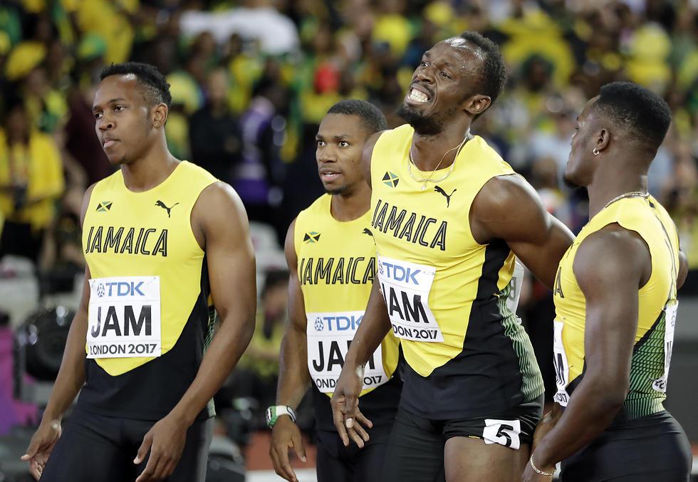 בולט וחבריו בסיום הריצה המאכזבת (צילום: AP)