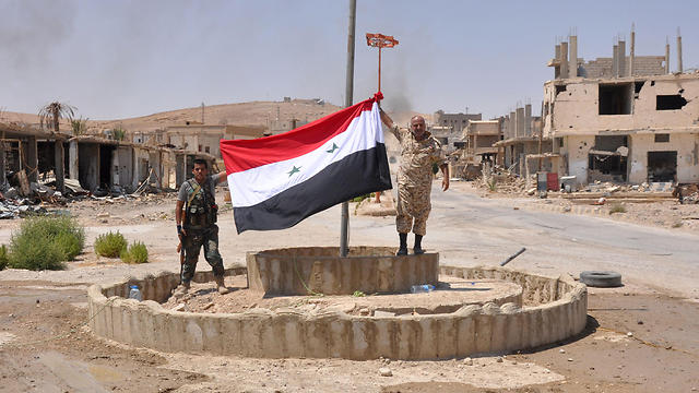 Assad army raising Syrian flag after victory near Jordanian border (Photo: AFOP)