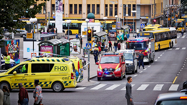 Emergency teams rush to the scene of the attack (Photo: EPA)