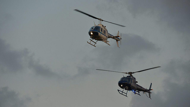 An aerial demonstration with the police's old helicopter (top) and the new H125 (Photo: Israel Police)