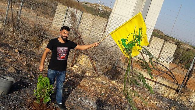 The Hezbollah standard and a newly planted tree near the Israel-Lebanon border