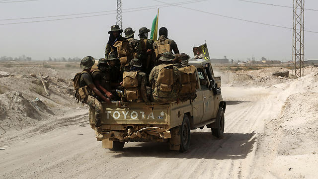 Shiite Popular Mobilization Forces fighters head to the front line to join the fight against ISIS, outside Fallujah, Iraq (Photo: AP)